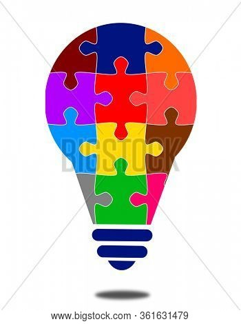 Light bulb in colorful puzzle