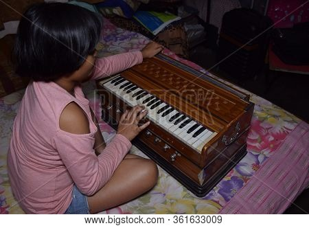 Delhi - India 11th April 2020 An Indian Child Practicing Music On A Harmonium