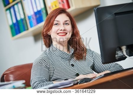 female accountant with documents in office. Accounting and tax service.