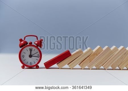 Time-limit. Lack Of Time And Deadline. Domino Effect. Red Alarm Clock And Wooden Block, Copy Space.