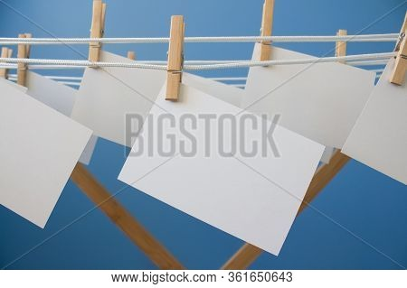 Notepaper Pin With Clothespins Hanging On Rope As Creative Background With Copy Space, Mockup