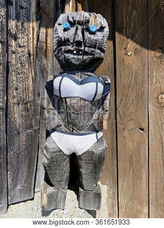 A Humorous Wooden Sculpture On A Secluded Alpine Farm, Einsiedeln - Canton Of Schwyz, Switzerland (s