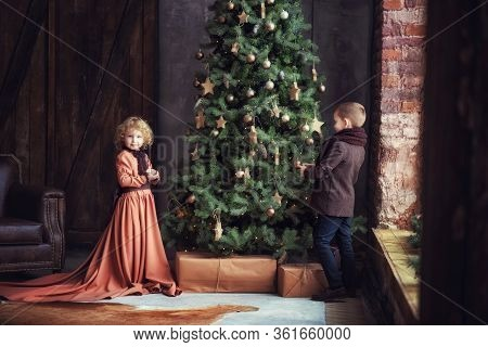 Two Children Boy And Girl Brother And Sister Siblings In Brown Vintage Retro Clothes Decorating Big