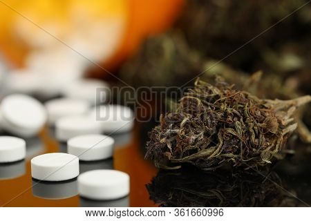 On Table Are Pills And Natural Dried Marijuana. Potent Drugs. Pronounced Sedative Effect Hemp Is Use