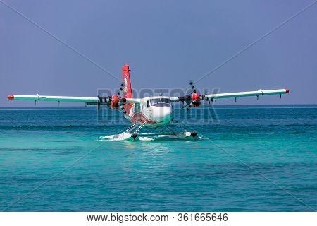 Ari Atoll, Maldives - 05.05.2018: Maldives Seaplane On Luxury Resort, Wooden Jetty Loading The Plane