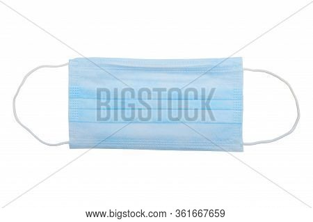 Top View Of One Surgical Disposable Face Mask Pp 3-ply With Earloop Isolated On White Background - U
