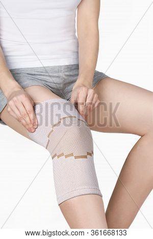 Knee Support Brace On Leg Isolated On White Background. Orthopedic Anatomic Orthosis. Braces For Kne