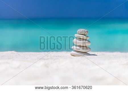 Zen Stones On Tropical Beach For Perfect Meditation. Stones Pyramid On Soft Sandy Beach Symbolizing