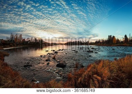 The Sunset Colors The Nature Beautifully By A River At The Northern Finland.