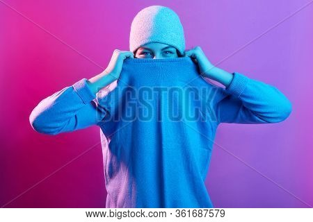 Close Up Portrait Of Woman Pulling Sweater On Her Face, Wearing White Cap, Trying To Hide, Posing Is