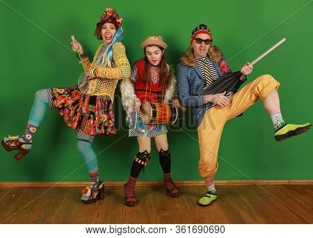 Fun Family Of Freaks Is Fooling Around By Depicting A Musical Group In A Studio On A Green Backgroun