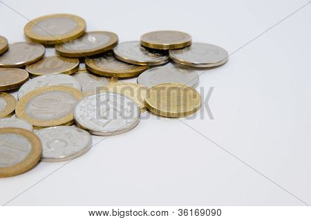 Heap of coins isolated on white background