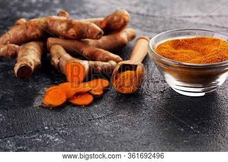 Turmeric Powder And Fresh Turmeric On Table