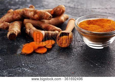 Turmeric Powder And Fresh Turmeric On Table