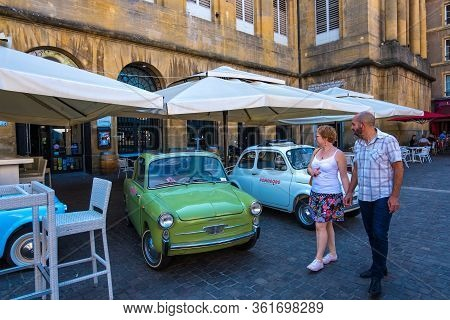 Metz, France - August 31, 2019: Cityscape With Restaurants And Cafe In Old Residential Buildings In