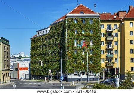 Vienna, Austria - September 2018: Scenic House With Green Creeping Plants At The City Streets