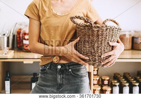 Woman With Wicker Basket, Reusable Cotton Bag And Glass Jars Buying In Plastic Free Grocery Store. S
