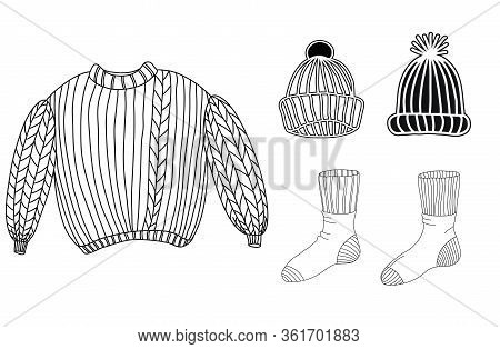 A Set Of Warm Winter Clothes. Sweater, Socks, Hats Isolated On A White Background. Cozy Home Things.