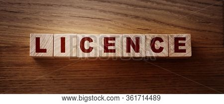 Licence Word Written In Wooden Cubes. Drivers Licence Or Legal Software Concept