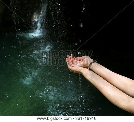 Women's Hands With Splashes Of River Water