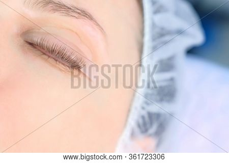 Womans Closed Eye With Bending Lashes On Curlers, Lift Eyelashes Laminaton, Closeup View. Making Las