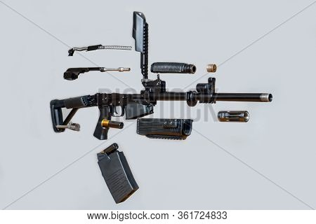 Disassembled Machine Gun Rifle Boar On A Gray Background. Isolated. Details Of Firearms In A Disasse