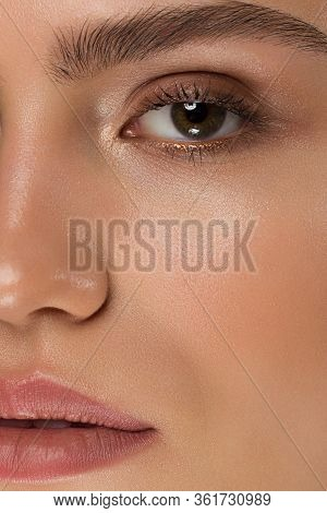 Half A Beauty Portrait With Beautiful Fashionable Evening Make-up, Black Smoky Eyes And Extremely Lo
