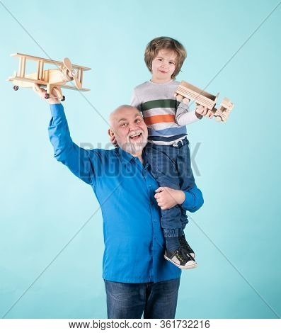 Family Generation Future Dream. Happy Grandfather And Grandson With Toy Airplane Over Blue Backgroun