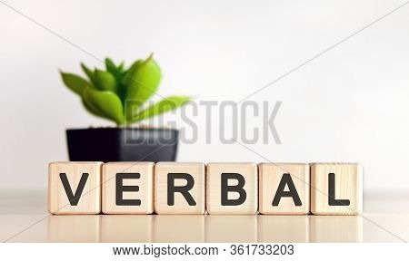 Verbal - Text On Wooden Cubes And Flower In A Pot In The Background