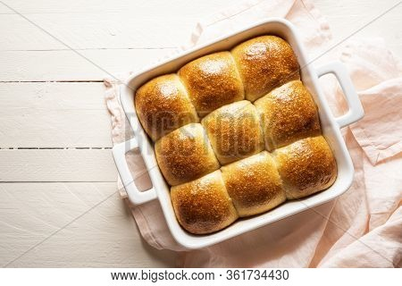 Pull Apart Bread Buns In A White Ceramic Tray On A Wooden Table Above View. Home-baked Bread Buns Ma