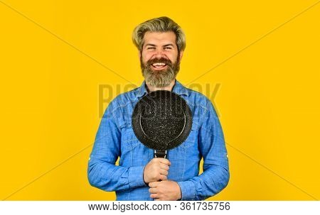 Eating At Home. Baker With Saucepan Pot. Catering. Chef Man Holds Kitchenware. Happy Cook Man Hold F