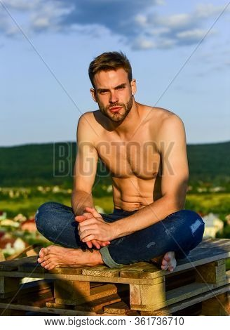 Relaxing After Training. Sexy Man Undressed In Jeans. Male Fashion Model On Sky Background. Summer R