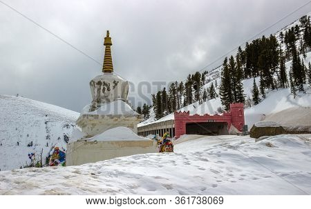 Winter Landscape Of The Buddhist Stupa Near Avalanche Gallery On The Federal Highway Yenisei In The