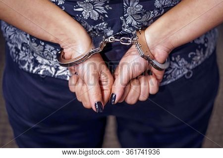 Arrested Woman Handcuffed Hands At The Back. Prisoner Or Arrested Terrorist, Hacker, Bribetaker, Clo