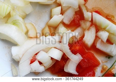 Close Up Onions And Tomatoes Cut For Cooking