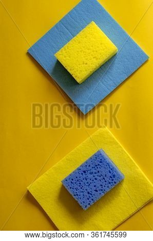 Kitchen Sponges And Cleaning Napkins On A Yellow Background.