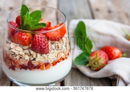 Yogurt With Muesli And Fresh Strawberries For Healthy Breakfast Or Snack. Strawberry Dessert Parfait