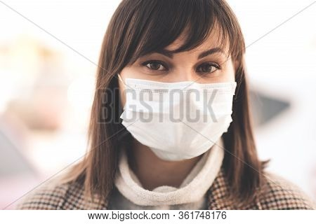 Young Sick Asian Girl 24-26 Year Old Wearing Medical Mask Outdoors Posing In City Street. Looking At