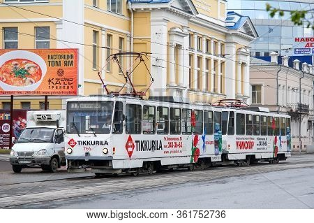 Ekaterinburg, Russia - May 9, 2012: Articulated Trolley Tatra T6b5su In The City Street.