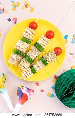 Mini Shaped Sandwich Kabobs With Cheese, Ham, Cherry Tomato, Cucumber And Wholemeal Bread Over Yello