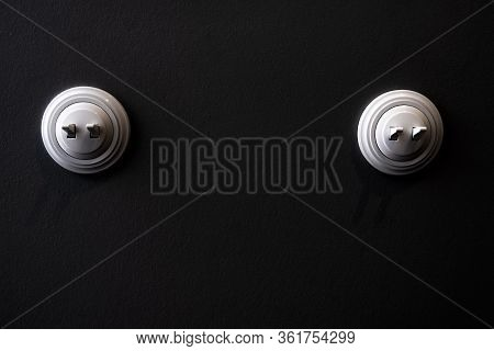 Two Beautiful Light Switches On A Black Wall. Dimmer On The Switch. Electrical Switch With Dimmer.