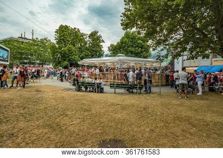 Vevey, Switzerland - July 27 2019: Tourists And Local People Celebrate Fete Des Vignerons 2019. Trad