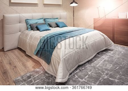 Relaxation Concept. Classic Interior Design Bedroom Beige Gray And Blue, Interior Of A Bedroom With