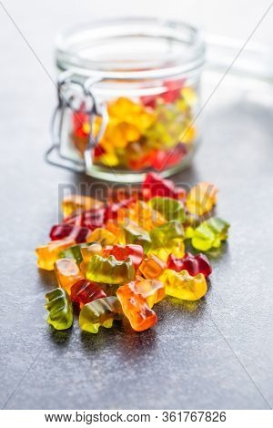 Gummy bears, jelly candy. Colorful bonbons on table.