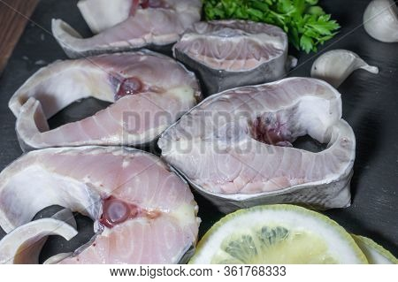 Fresh Raw Sturgeon Steaks On Dark Backround
