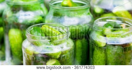 The Process Of Canning Pickled Gherkins For The Winter, Pickles Cucumbers In Glass Jars Close-up.