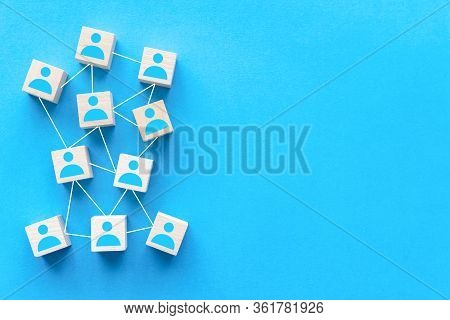 Connecting People Or Social Media Networking Concept Using Wood Square Block On Blue Background