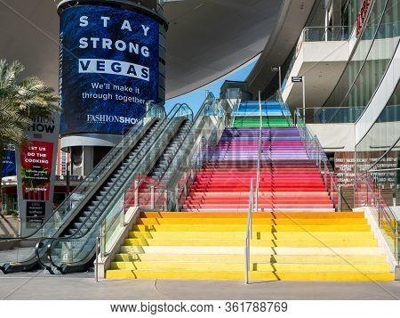 11 April 2020, Las Vegas, Nevada, Usa, Deserted Rainbow Colored Steps, Shut Down Escalator, And Stay