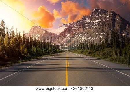 Scenic Road In The Canadian Rockies During A Vibrant Sunny Summer Sunrise. Sky Composite. Taken In I