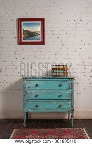 White Brick Wall With Shabby Chic Vintage Turquoise Cabinet And Hanged Painting In Living Room, With